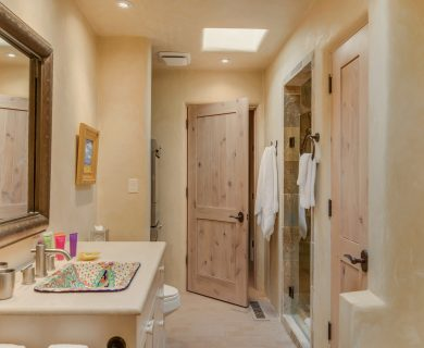 Santa Fe Vacation Rental Master Bathroom with Rustic Pine Doors