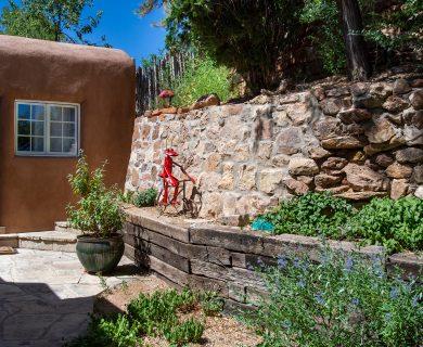 Classic Santa Fe Backyard With Rock Wall